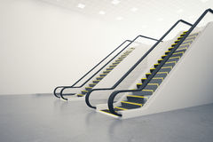 Two escalators and blank wall. Side view of two escalators in concrete room with blank wall. Mock up, 3D Rendering Stock Image