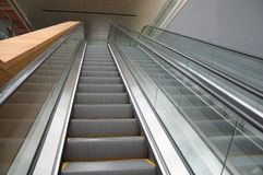 Two escalators going up and down Royalty Free Stock Photo