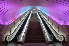 Two Escalators with Pink Light overhead Royalty Free Stock Images
