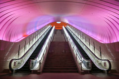 Two Escalators with Pink Light overhead Stock Photos