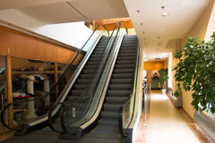 Two escalators in shopping mall. Two escalators in modern shopping mall Stock Image