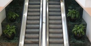 Two escalators side by side royalty free stock images
