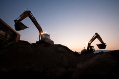 Two escavators working on a mine Royalty Free Stock Photos