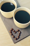 Two espresso coffees in small white cups with heart shape Royalty Free Stock Photos