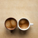 Two espresso cup on brown table. As black and white lovers. Free space for text Royalty Free Stock Image