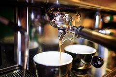 Espresso pouring from espresso coffee machine. Hot beverages. Two espresso pouring from espresso coffee machine. Hot beverages, coffee preparation and barista royalty free stock images