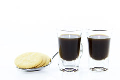 Two espresso shots with cracker Stock Photo