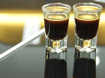 Two espresso shots reflection Royalty Free Stock Photos