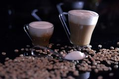 Two espresso. Coffees with coffee beans royalty free stock image