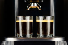 Two espressos in glass cups. Two espresso coffees in glass cups on coffee machine Stock Photos
