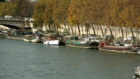Two establishing shots of the grand palais and the Seine in Paris with touristic boats. stock video footage