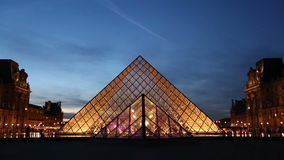 Two establishing shots of the pyramide at Louvre in Paris stock video