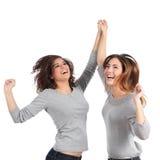 Two euphoric girls jumping royalty free stock photos