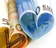 Two euro bill in the form of a heart Stock Photography