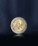 Two euro coin. Dark background with backlight Stock Photo