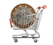 Two euro coin. In a shopping trolley on white background Royalty Free Stock Images