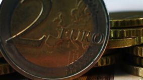 Two Euro Coin. Extreme Close Up Two Euro Coin On Stack Of Many Euro Coins And Banknote stock video