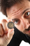 Two euro coin in hand Royalty Free Stock Image