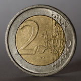 Two euro coin. Low key. Royalty Free Stock Photography