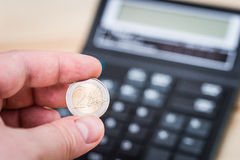 Two euro coin in the man's hand Stock Image