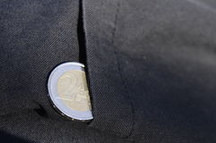 Two euro coin protruding from a pocket Royalty Free Stock Images