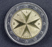 Two Euro coin from the Republic of Malta. Two Euros from the Republic of Malta, Europe over white background Royalty Free Stock Photo
