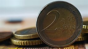 Two Euro Coin. On Stack Of Many Euro Coins And Banknote stock video