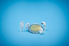 Two euro coins being inspected by specialist Royalty Free Stock Photos