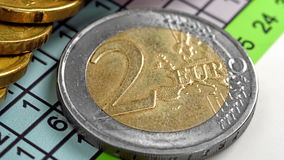 Two euro coins. And business report, close up stock footage