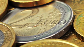 Two Euro coins. Two Euro coin and many coins, close up stock footage