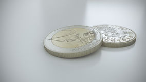 Two Euro coins on a white reflective surface. 3 D render of two Euro coins on a white reflective surface. One coin is laying on a white surface while the other Royalty Free Stock Photos