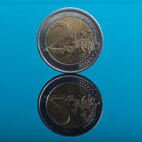 Two Euro money coin on blue with reflection Royalty Free Stock Image