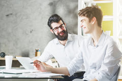 Two european businessmen working on project together Royalty Free Stock Image