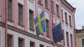 Two European flags, Swedish and EU on the building of the Consulate General of Sweden, St. Petersburg stock footage