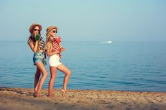 Two European girls have fun in the summer on the beach Royalty Free Stock Photos