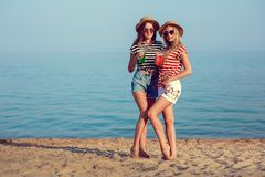 Two European girls have fun in the summer on the beach Royalty Free Stock Image