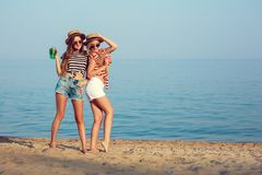 Two European girls have fun in the summer on the beach Stock Images