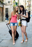 Two european students on vacation with luggage Stock Image