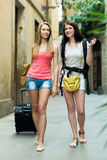 Two european travelers on road to hotel on foot Stock Photos