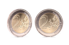 Two euro coins with shadows Royalty Free Stock Photography