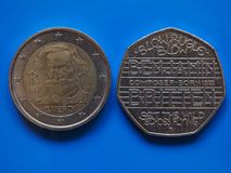 Two Euros and 20 Pence coin over blue Royalty Free Stock Photo