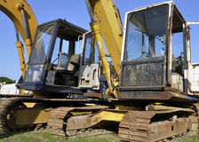 Used excavators, blue sky. Used excavators, heavy scrap, blue sky Stock Images