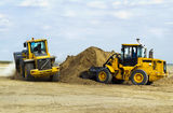 Two excavators move the earth on a site of construction of the r. Construction of the road, digging works by means of special equipment Stock Photography