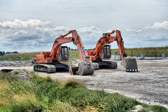 Two excavators on site Royalty Free Stock Photo