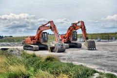 Two excavators on site Royalty Free Stock Photo