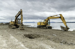 Two excavators working in a new road construction Royalty Free Stock Photo