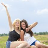 Two excited friends waving their hands Royalty Free Stock Photos