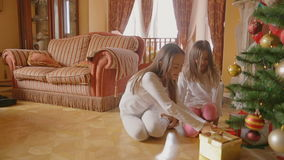 Two excited girls running to the living room after Christmas to open gifts. Two girls running to the living room after Christmas to open gifts stock footage
