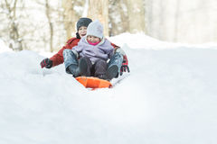 Two excited siblings shouting during winter Royalty Free Stock Photo