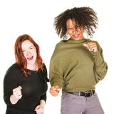 Two excited women dancing Stock Images